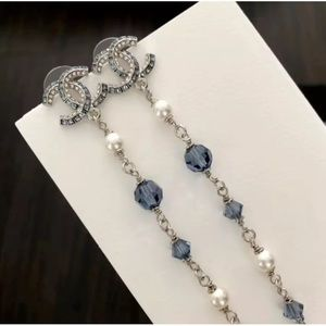 Authentic Chanel Blue Stone and Pearl Earrings